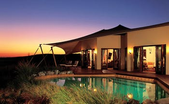 Al Maha Desert Resort and Spa Dubai Royal suite pool building with tented awning and private pool at night