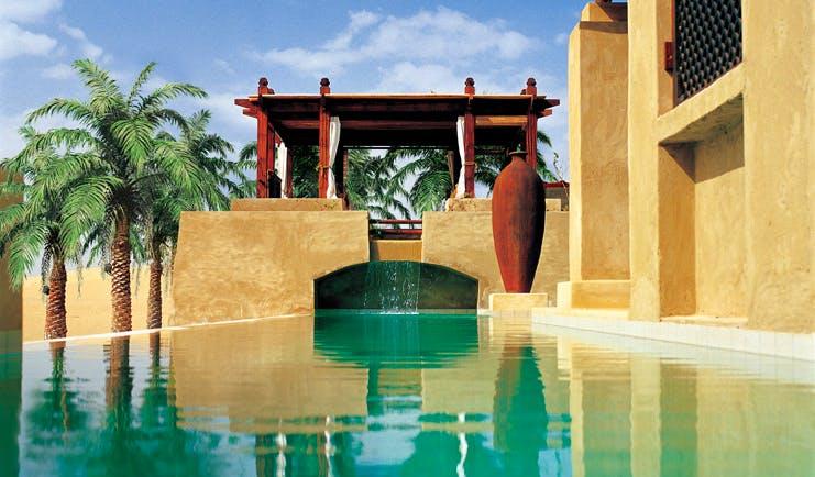 Bab Al Shams Desert Resort and Spa Dubai outdoor pool with cabana and palms