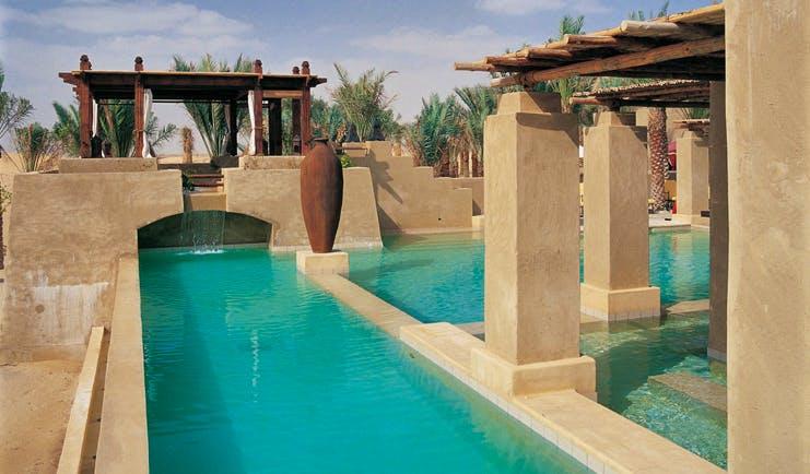 Bab Al Shams Desert Resort and Spa Dubai swimming pool with covered areas and cabana