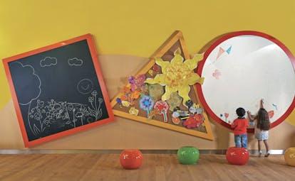 Fairmont the Palm Dubai kids club children drawing on whiteboard