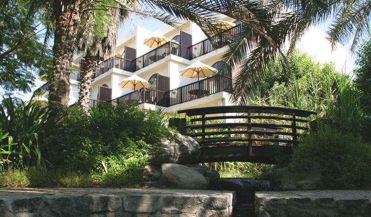 Palm Tree CourtJebel Ali Dubai exterior building with balconies overlooking garden with bridge