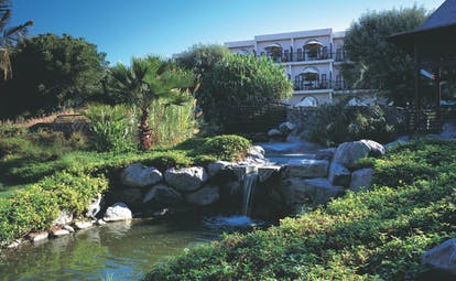 Palm Tree Court Jebel Ali Dubai gardens with stream and waterfall