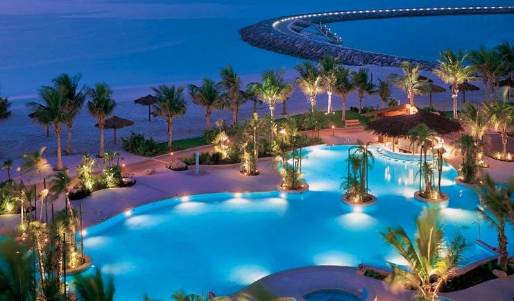 The Jumeirah Beach Hotel Dubai aerial view pool near the beach with palms