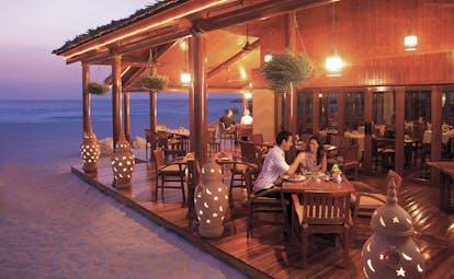 The Jumeirah Beach Hotel Dubai beach restaurant couple at decked restaurant on the beach