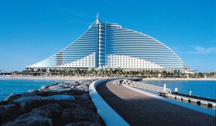 The Jumeirah Beach Hotel Dubai exterior bridged walkway to large glass fronted hotel and beach