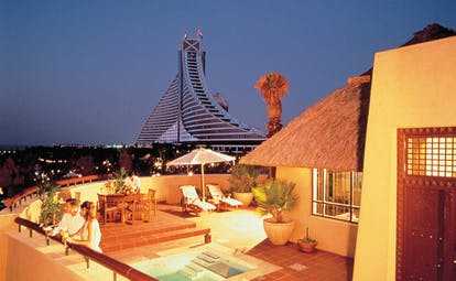 The Jumeirah Beach Hotel Dubai villa terrace balcony with pool seating area and view of hotel