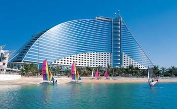 The Jumeirah Beach Hotel Dubai windsurfing on the beach overlooked by hotel