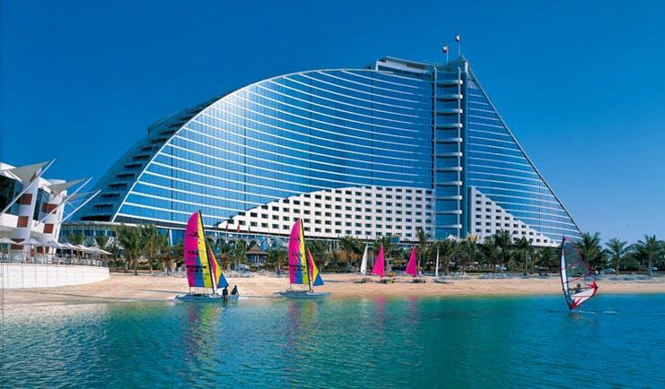 The Jumeirah Beach Hotel Dubai windsurfing on the beach overlooked by hotel