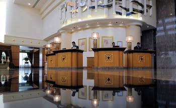 Le Royal Meridien Beach Resort and Spa Dubai lobby with several reception desks