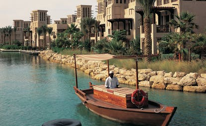 Madinat Jumeirah Dubai complex of buildings with balconies overlooking traditional boat