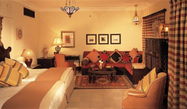 Madinat Jumeirah Dubai Dar Al Maysaf bedroom with sofa and armchair