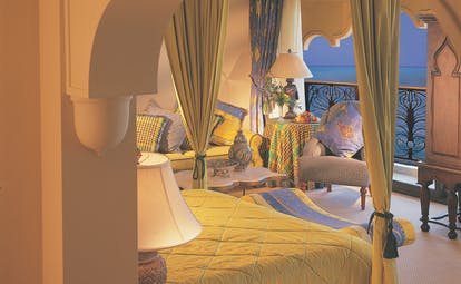 Madinat Jumeirah Dubai suite bedroom with armchair and wardrobe