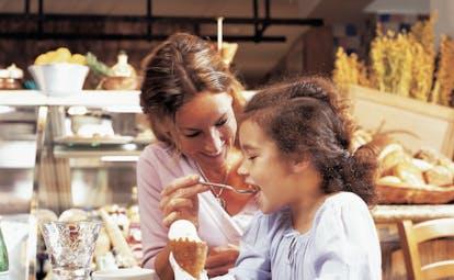 Madinat Jumeirah Dubai Trattoria Toscana woman feeding a child an ice cream