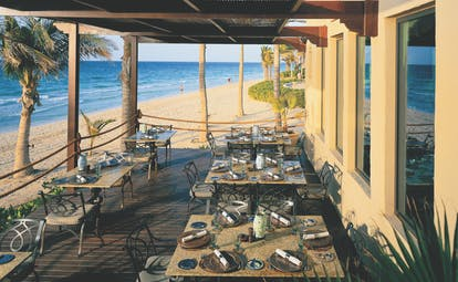 One and Only Royal Mirage Dubai beach bar outdoor dining area on deck next to the beach