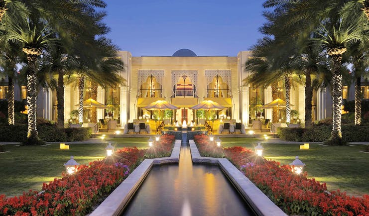 One and Only Royal Mirage Dubai exterior with fountain at night