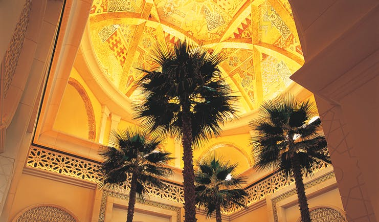 One and Only Royal Mirage Dubai lobby with traditional Arabic decorative features and palms