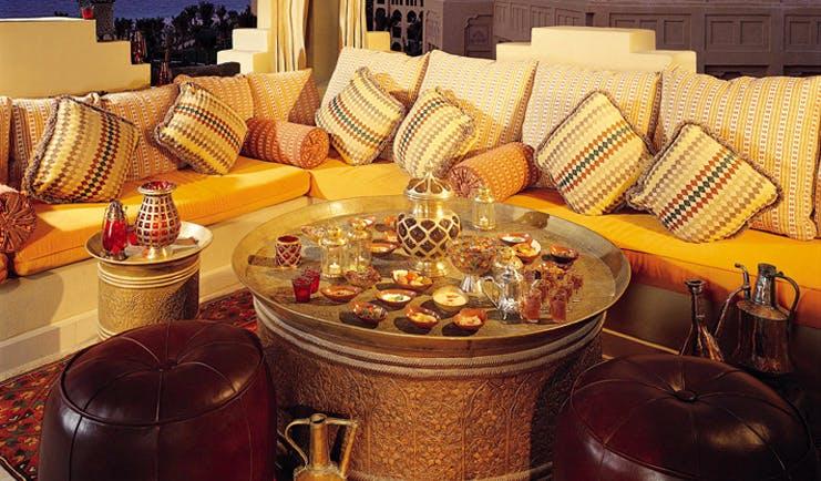 One and Only Royal Mirage Dubai lounge area with sofa tea and shisha pipe