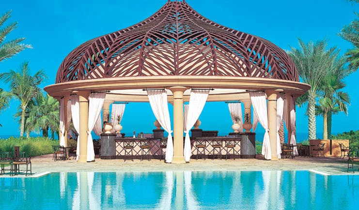 One and Only Royal Mirage Dubai pool bar with pergola and bar area