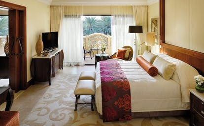 One and Only Royal Mirage Dubai superior executive bedroom with armchair television and balcony
