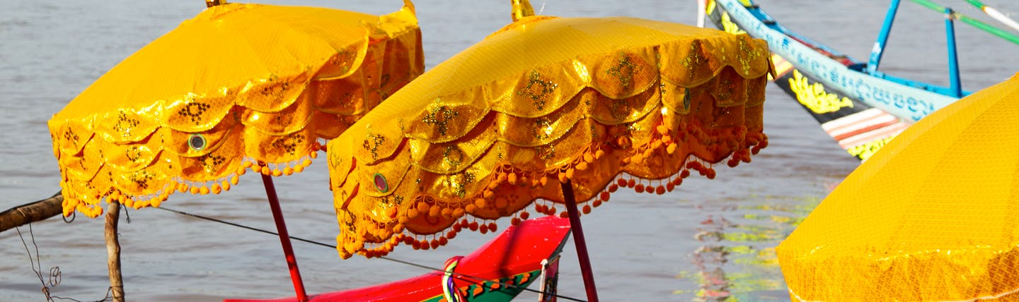 Traditional colourful racing boats on the river in Cambodia
