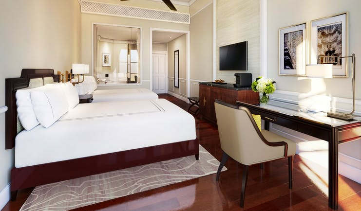 Raffles d'Angkor state room, double bed, desk, elegant decor in a colonial style