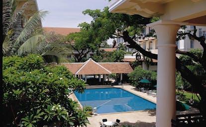 Raffles Hotel Le Royal Cambodia aerial pool gardens trees hotel building