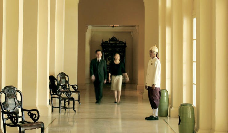 Raffles Hotel Le Royal Cambodia hallway couple staff member in formal uniform