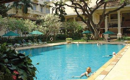 Raffles Hotel Le Royal Cambodia hotel pool courtyard gardens loungers