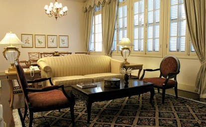 Raffles Hotel Le Royal Cambodia sitting room classic decor sofa chandelier