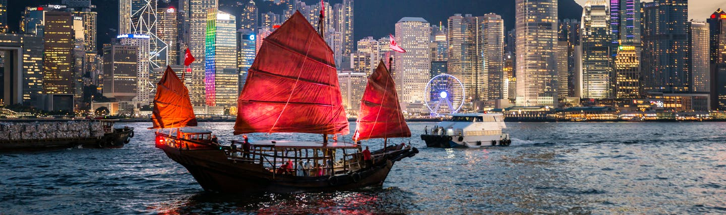 Junk boat sailing on harbour in Hong Kong