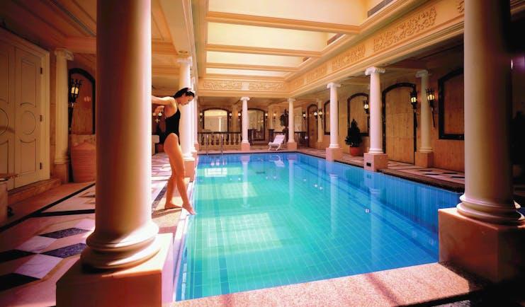 Mandarin Oriental Hong Kong pool indoors ornate architecture woman dipping toe in
