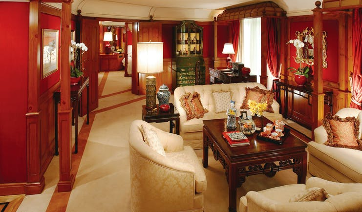 Mandarin Oriental suite with sofas, armchairs and wood pannelled walls