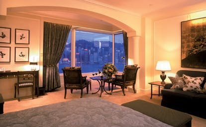The Peninsula Hong Kong deluxe harbour view suite bedroom sofa dining area city and harbour view