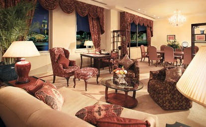The Peninsula Hong Kong deluxe suite lounge classic decor seating area armchairs curtain drapes