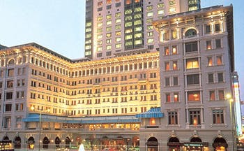 The Peninsula Hong Kong exterior shot large white hotel with awnings