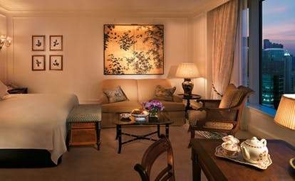 The Peninsula Hong Kong grand deluxe bedroom classic decor sitting area city view