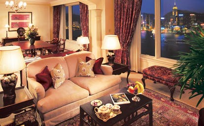 The Peninsula Hong Kong grand deluxe suite lounge sofa ottoman tea service dining area city view