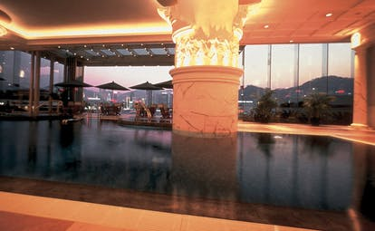 The Peninsula Hong Kong indoor pool columns panoramic city view