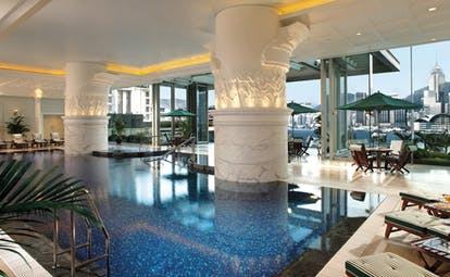 The Peninsula Hong Kong indoor swimming pool loungers seating area panoramic city view