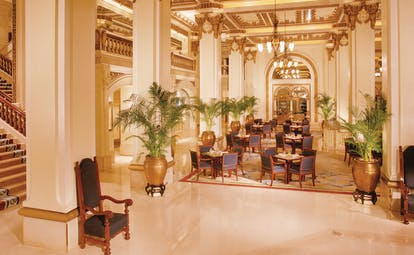The Peninsula Hong Kong lobby seating area opulent decor large vases with plants