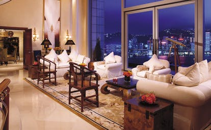 The Peninsula Hong Kong lounge seating area sofas armchairs telescope panoramic city and harbour view