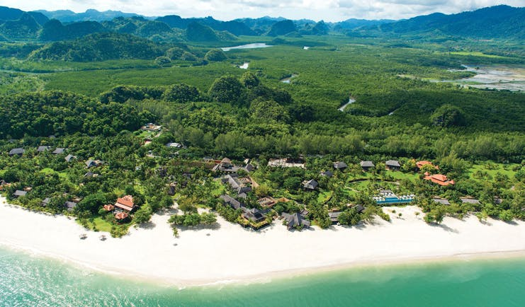 Four Seasons Langkawi Malaysia beach and resort aerial shot white sand hotel buildings rainforest