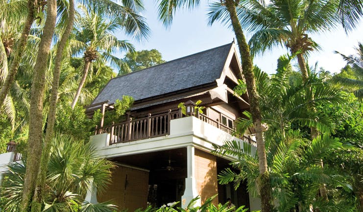Pangkor Laut Malaysia garden villa exterior surrounded by trees and plantsw
