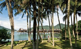 Pangkor Laut Malaysia sea villas on stilts gardens trees rainforest in background