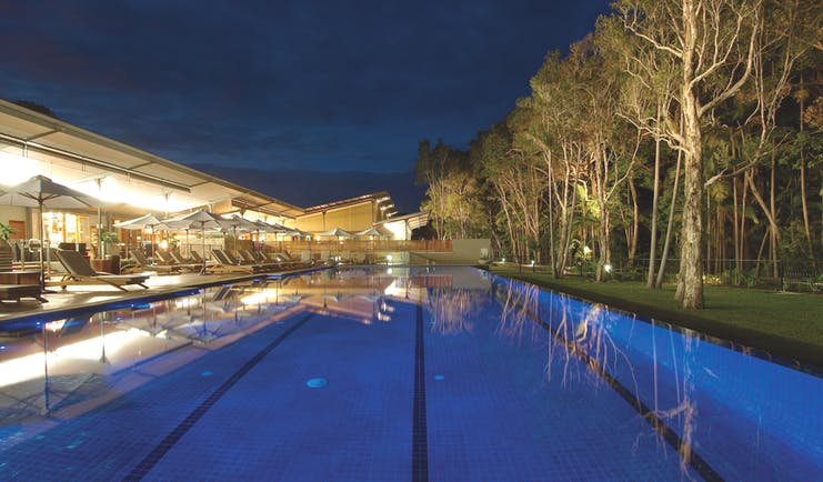 The Byron at Byron New South Wales outdoor pool with loungers and umbrellas at night