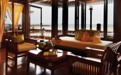 Tanjong Jara Malaysia Anjung suite lounge tables chairs windows overlooking beach