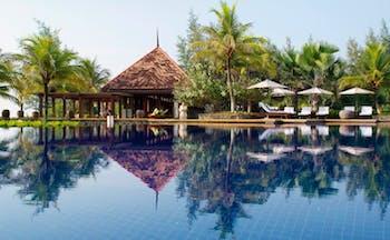 Tanjong Jara Malaysia infinity pool sun loungers umbrellas trees