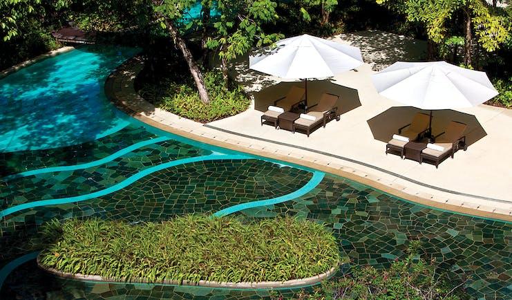 The Andaman Langkawi Malaysia pool terrace sun loungers umbrellas