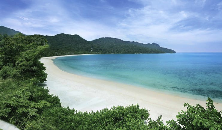 The Andaman Langkawi Malaysia beach white sand sun loungers boat island in distance