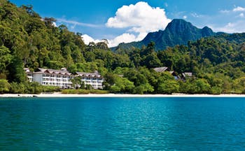 The Andaman Langkawi Malaysia hotel exterior view from the sea rainforest in background